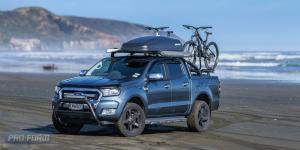 Blue Ford Ranger T6 ute on beach
