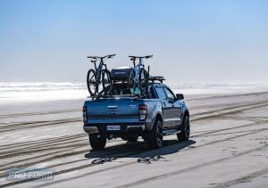 Blue Ford Ranger T6 ute on beach with ute lid