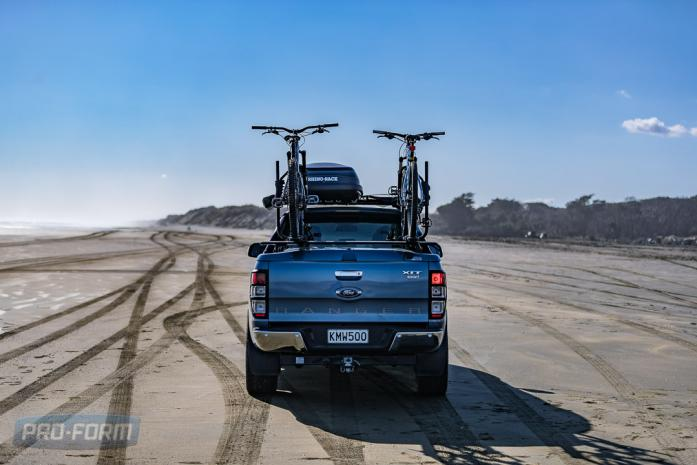 Blue Ford Ranger T6 ute on beach with ute lid