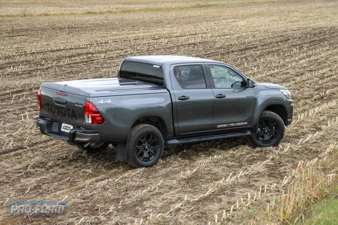 Grey Toyota Hilux with OEM bar and Sportlid for Tango Tonneau cover