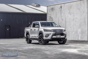 White DTM toyota hilux with sportlid for tango