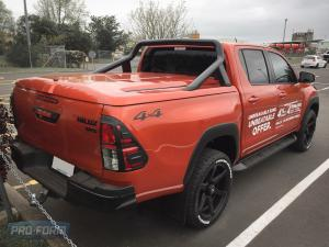 orange Toyota Hilux with OEM bar and Sportlid for Tango Tonneau cover back of ute