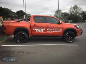 orange Toyota Hilux with OEM bar and Sportlid for Tango in nz Tonneau cover