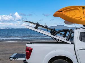 White Nissan Navara NP300 Sportlid for Tango on north auckland beach