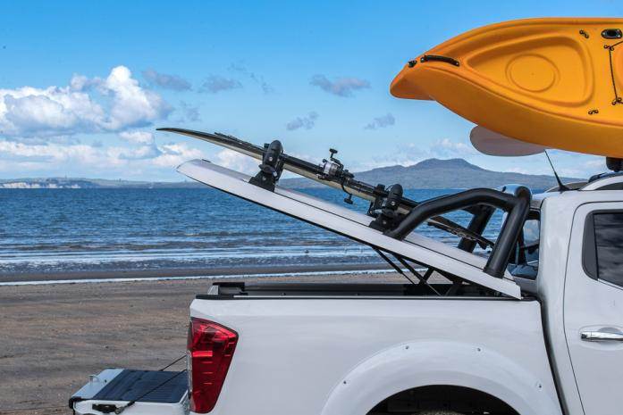 White Nissan Navara NP300 Sportlid for Tango on north auckland beach