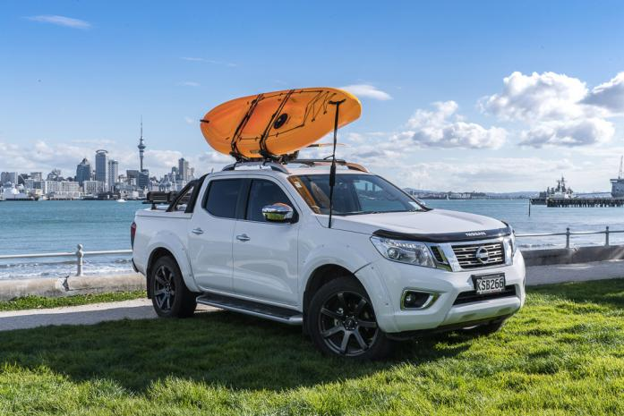White Nissan Navara NP300 Sportlid for Tango with view of auckland