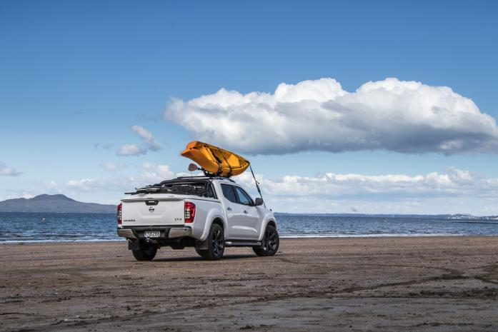 Nissan Navara Ute with hard cover lid and kayak