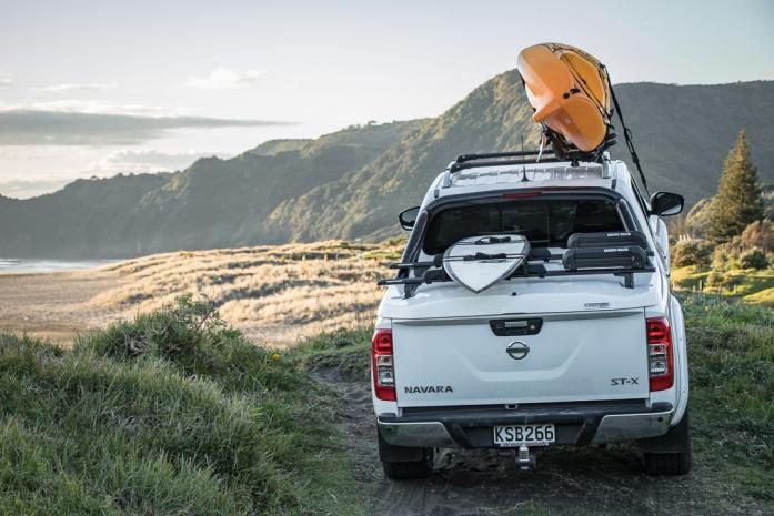 White Nissan Navara NP300 Sportlid for Tango with view of piha beach
